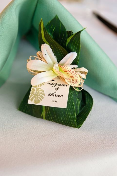 Personalized Wedding Favor Wrapped In A Tropical Leaf With Flower Accent Shared Roundup Post On Mariage