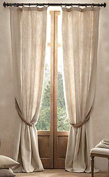 linen curtains (19 for two at Ikea) , rope tieback (.59 cents a foot at Lowes)
