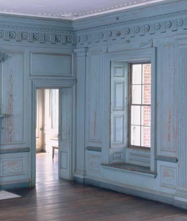 Raised-panel shutters fold back into deep window recesses at Drayton Hall, an 18th-century mansion in Charleston, South Carolina.