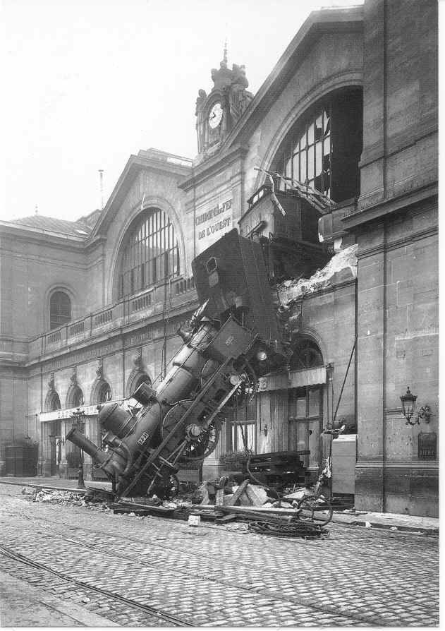 Famous photo:  October 22, 1895 after Granville-to-Paris Express plowed through the wall of the Gare Montparnasse Train Station, Paris, France