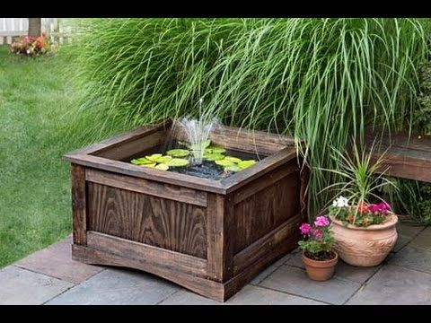 An Outdoor Fish Tank Made From Clay Plant Pot With A Lotus Flower Eco System