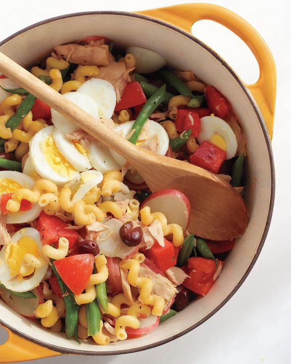 All the elements of salad nicoise -- tuna, tomatoes, green beans, potatoes, and boiled eggs are here. We ditched the lettuce base in favor of fusilli pasta for an easy, summery, and colorful meal.