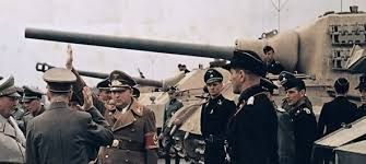 Adolf Hitler and Reichsleiter Martin Bormann inspect a Panzer battalion, with newly assigned Jagdtiger, during a inspection of new types of armored vehicles.