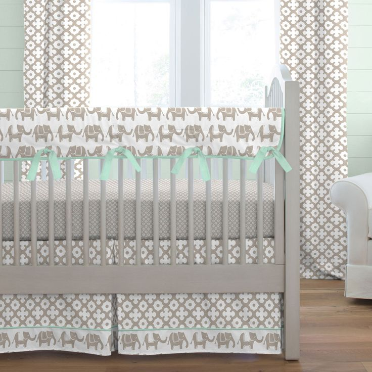 Taupe and Mint Elephants Crib Bedding by Carousel Designs.  As strong and brave as he can be, this little elephant marches along for all to see. He would love to march right into your nursery and bring lots of smiles to little faces. Featuring neutral shades of taupe and mint this collection will fit into any nursery decor.