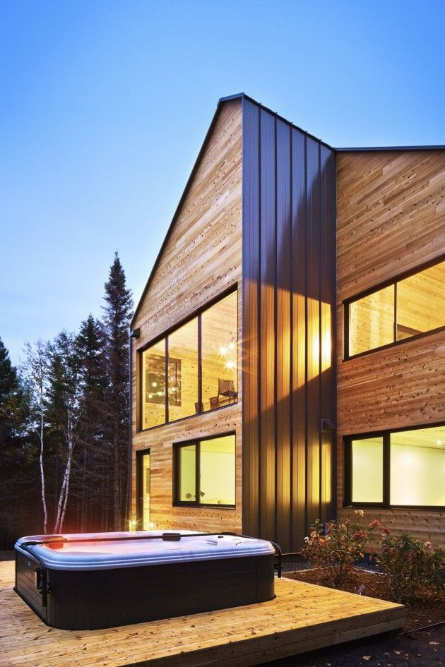 MU Architecture have designed the Malbaie VIII Residence, located in the Charlevoix region of Quebec, Canada.