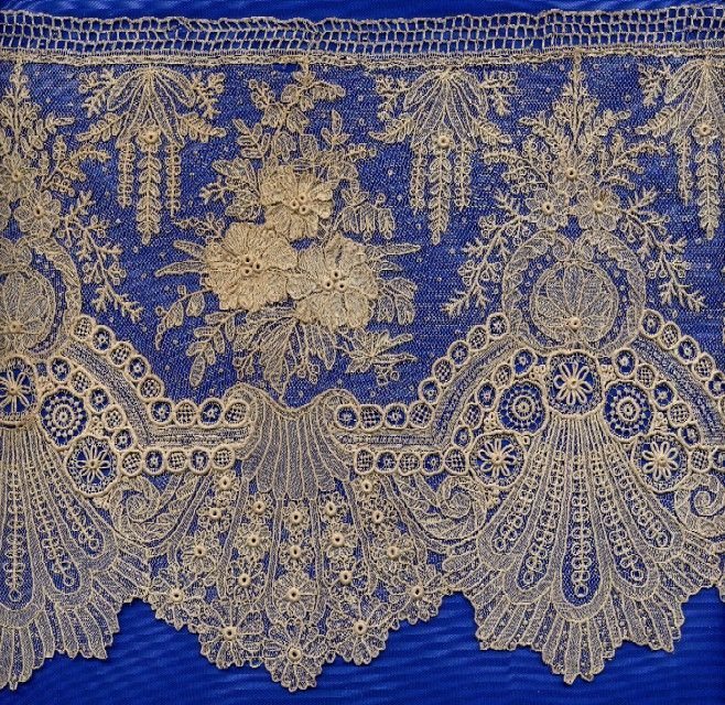 Brussels Lace Very delicate elaborate lace, often lots of raised work like what you see in the centers of the flowers. You don't see this much on modern gowns--it is very old fashioned.