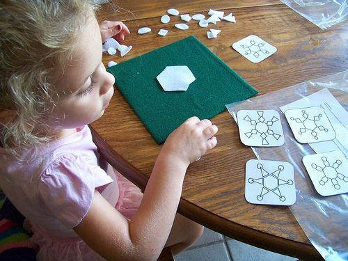 Busy bag idea.  Felt snowflake puzzles.  I'm in the process of making all the stuff for this.  So far the kids like just helping laminate the cards...haven't even tried the puzzles yet!