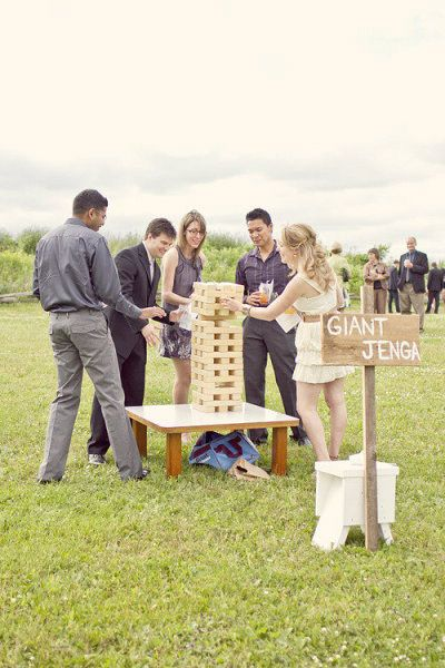 Fun Wedding Reception Activities: lawn games such as giant Jenga, bocce ball, badminton, mini golf, corn hole, ring toss, horse shoes, croquet, etc. | Photo: Young Hearts Photography