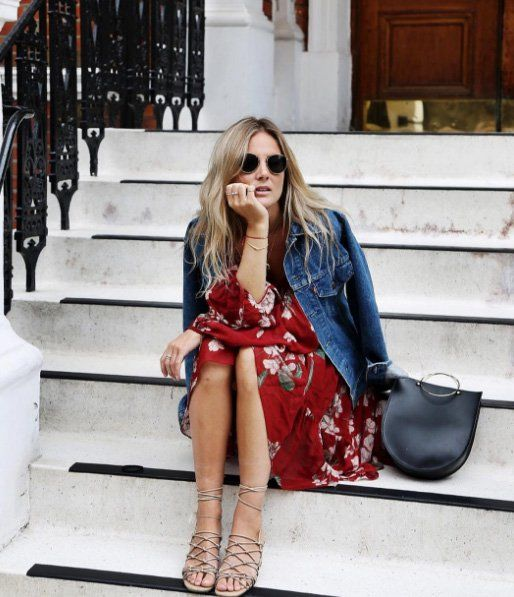 A deep red floral dress with a denim jacket and strappy sandals.