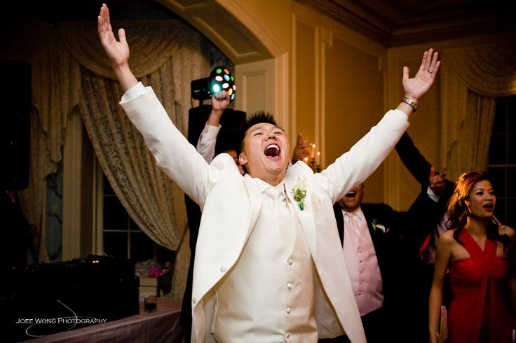 Now this groom is having a great time at his wedding at Graydon Hall Manor!  Photo by Joee Wong - Music by Michael Coombs.
