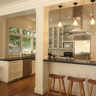 Beam in kitchen... I want to take my wall by the kitchen, dinning room, and living room out and do this! Love the openness!