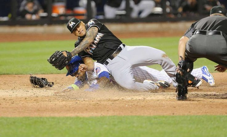 Shortstop Jose Reyes of the New York Mets scores on a wild pitch and collides with Jose Fernandez during an August 2016 game in New York City.   -   Marlins plan to unveil Jose Fernandez sculpture  -  April 13, 2017