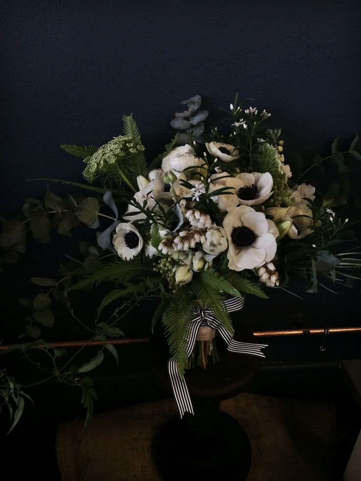 A black white and green bouquet for Nicole one of our September Spring brides!