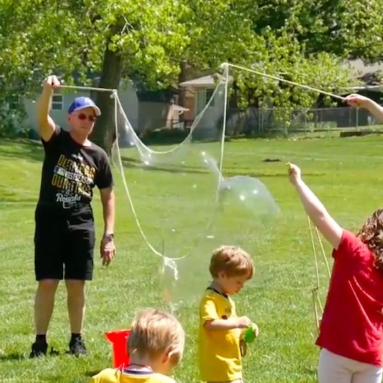 You can put together this giant DIY bubble wand in less than 15 minutes. Fun for the whole family.