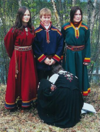Samekofte fra Porsanger, Norway. The traditional Sami costume is characterized by a dominant color adorned with contrast colored bands, plaits, pewter embroidery, tin art, and often a high collar. In the Norwegian language it is called 'kofte',