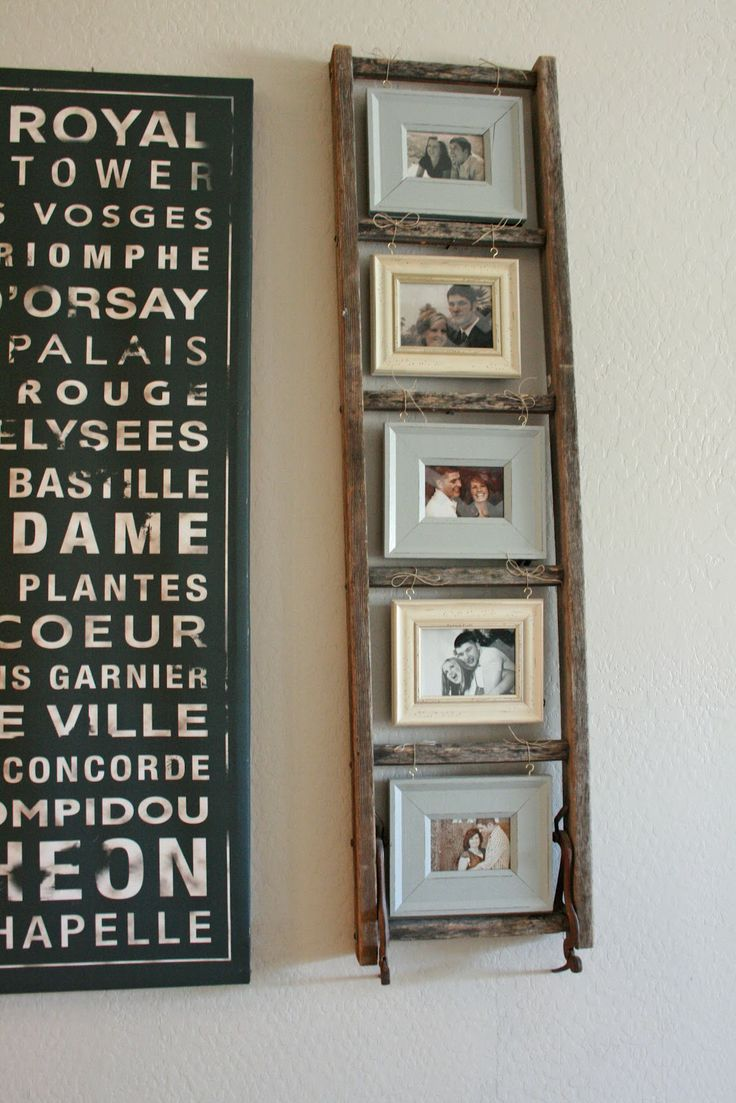 cool way to do picture frames....small old ladder. string. hooks and frames!