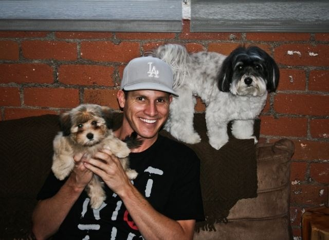 Daniel Tosh with puppies. Need I say more?