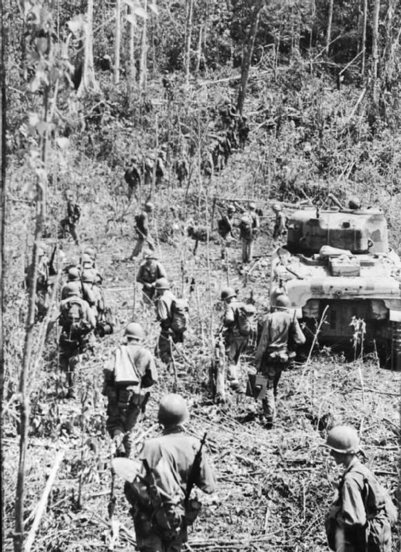 The Campaign in the Dutch East Indies, April – September 1944: American infantry advance behind a Sherman tank on the island of Biak. On Biak the Americans encounted stiff opposition and the island was not taken until August 1944