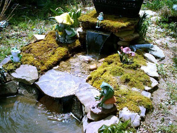 38 best pond images on pinterest ponds water feature for Pond waterfall spillway ideas