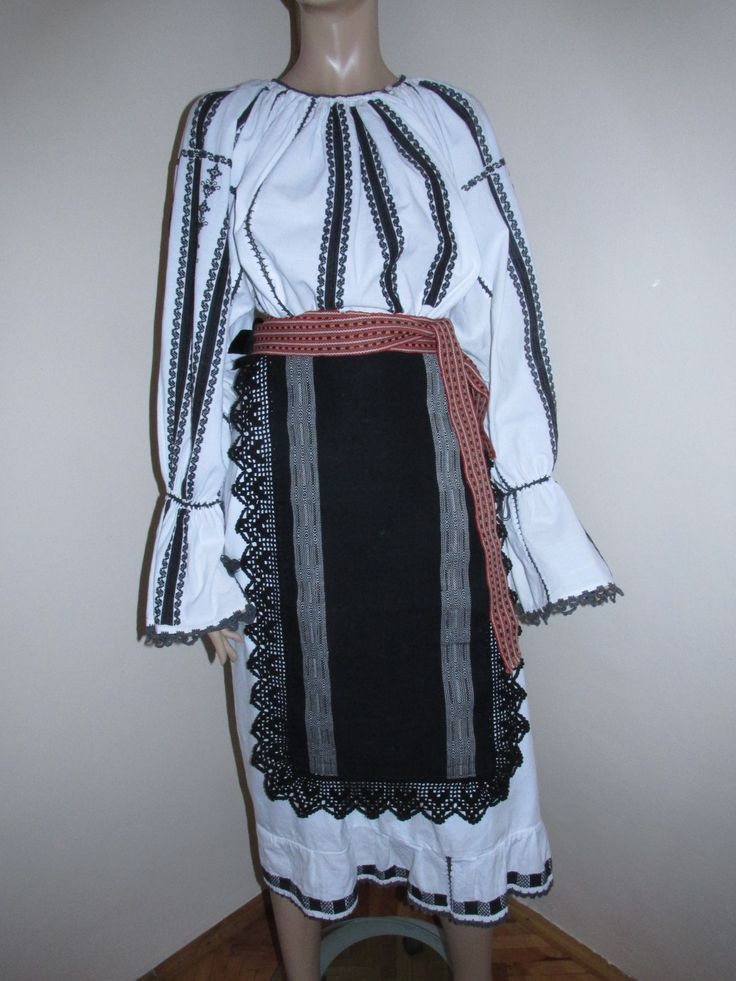 A genuine hallmark of the shepherds in Carpathian Mountains, in between Sibiu and Valcea counties, the costume of this area has a well defined personality through the black and white contrast which the basic pieces display.  Available at www.greatblouses.com