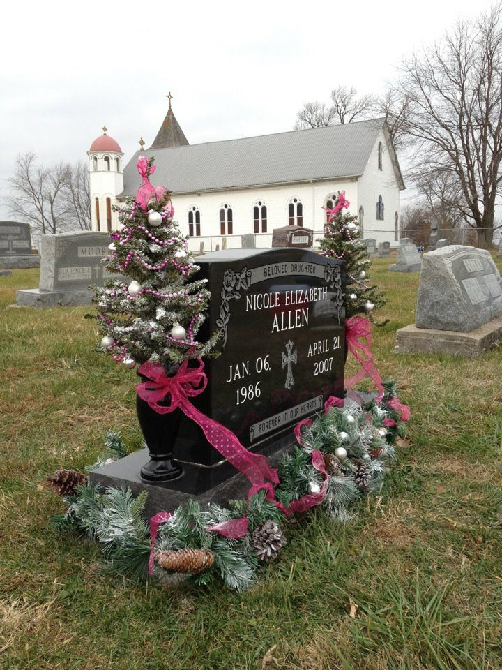 Another shot of the headstone with the church in the background.  Nicole's favorite color was pink and I think she would have liked the pink Christmas decorations.