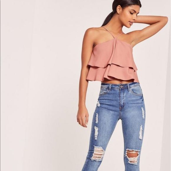 "Shop Women's Missguided Pink size 4 Crop Tops at a discounted price at Poshmark. Description: NWT never worn. Adjustable straps with zipper in the back. Size US 4. approx length: 20cm/8"". Sold out in missguided. Sold by samanimran. Fast delivery, full service customer support."