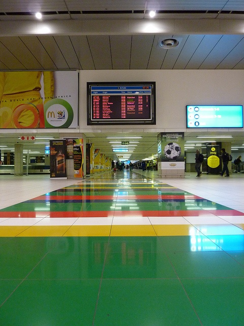 Rainbow Floor in South African flag colors at the Johannesburg Airport by cjmartin, via Flickr