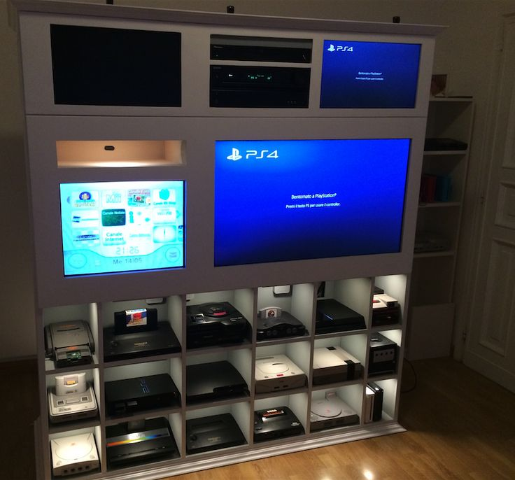 Custom video game shelves via Racketboy user wheeezy. Gaming unit with consoles, HDTV and CRT TV for retro games. Stylish game room.