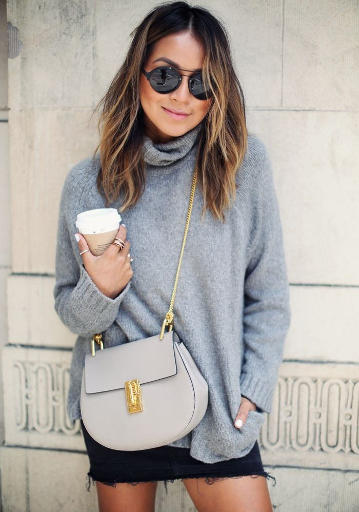 Jules from Sincerely Jules wearing a cozy cashmere sweater, black denim skirt and Chloe drew bag: