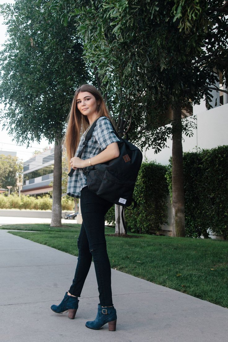 Olivia Giannulli, 15, a sophomore at a westside Catholic school, wears AG's plaid top with J Brand's jeans. Boots by Cole Haan; rings and necklace by My Jewel Bar; backpack by H&M.
