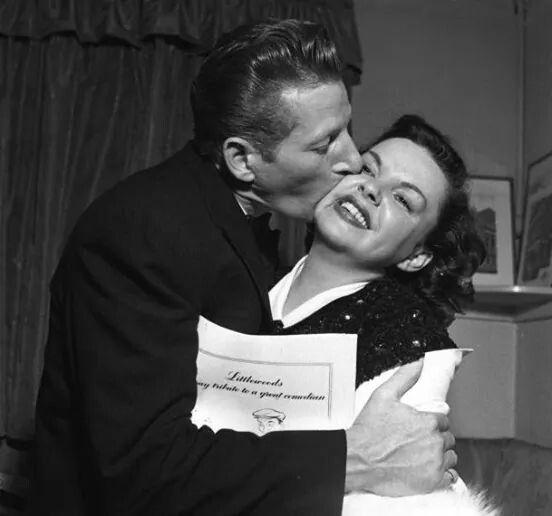 .Judy Garland.  Has to be Danny Kay smooching her!