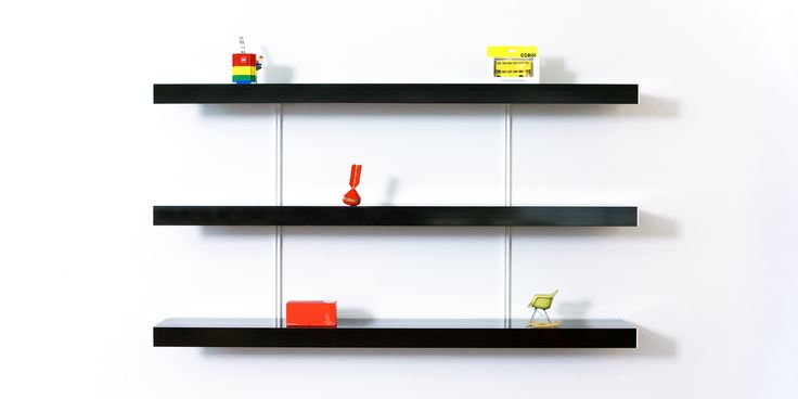 Black shelving system with adjustable white shelf fixings. Keep it simple and use our black shelving system to bring simple made to measure shelving into your space. Perfect for any modern home, office or retail space. Visit our website for free planning and design advice.