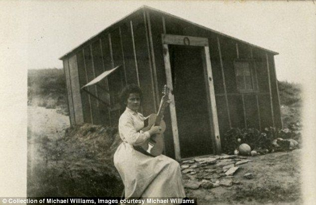 A woman poses with her guitar in front of her homestead on the Great Plains. --Photos of life on the American frontier.