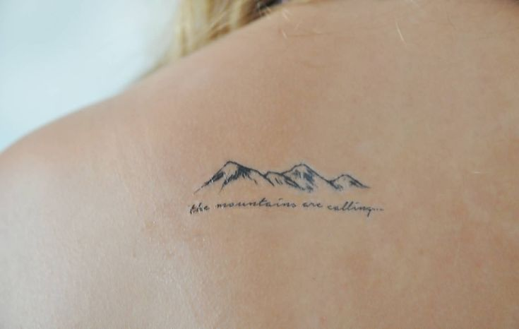 Smallest Simple Mountains With Lettering Tattoo On Upper Back