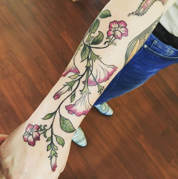 Like the color and the simplistic realism of this piece. - This perfectly drawn vine. | 31 Insanely Gorgeous Floral Tattoos