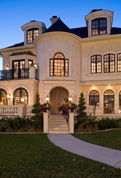 amazing home with turret cream colored exterior with dark roofing luxury home decor - Luxury Homes Exterior Brick