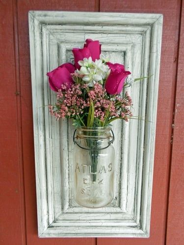 Mason Jar Vase on Repurposed Cabinet Door. How cool would this look full of autumn leaves in fall and Christmas greens for winter?