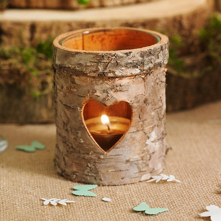 Truly rustic style bark tea light holders with glass (sold in sets of three).Available with 4 hour buring tea lights. Choose 1 tea light for every holder you buy or extra tea lights so you can use your holders again and again. Tea light candles are white in silver casing.The perfect way to add a warm glow to your home. The wooden tea light lanterns have a single heart cut out from them letting the candle light shine through. These rustic wooden tea light holders make beautiful gifts, they…
