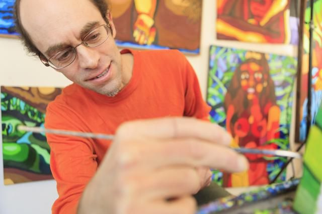 Learn Why There is No Real Autism Epidemic: A man with Aspergers painting in his art studio
