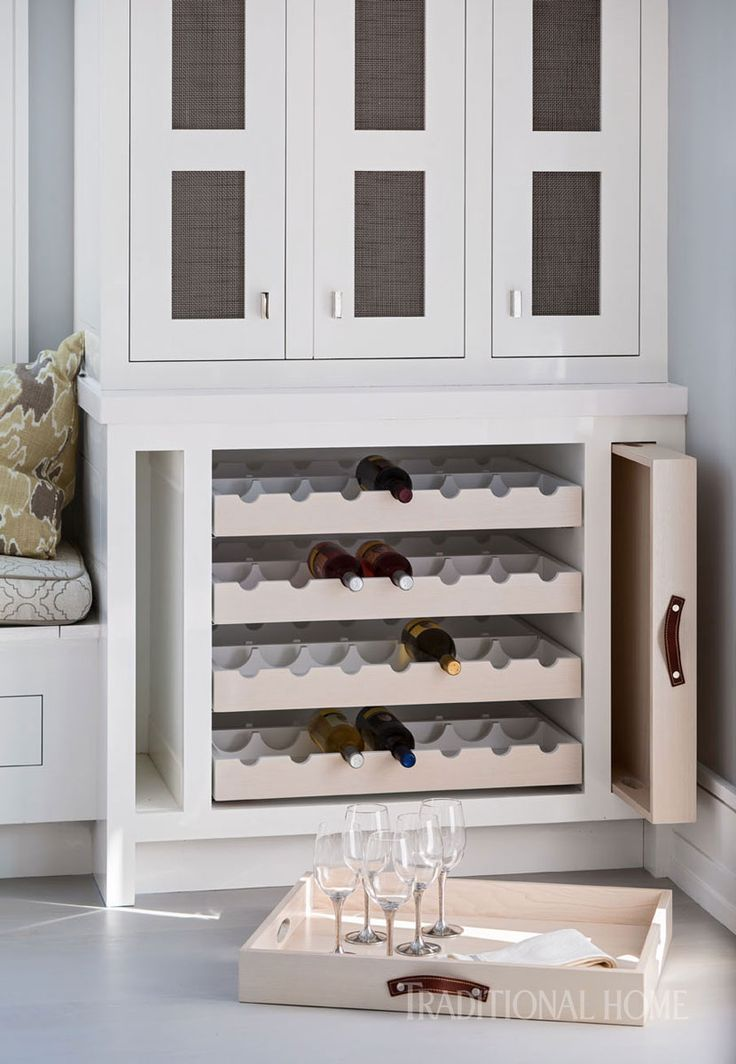 Kitchen cabinetry includes a custom wine storage unit with pullout serving trays. We'll take it! - Photo: John Bessler / Design: Robert Bakes and Paul Kropp
