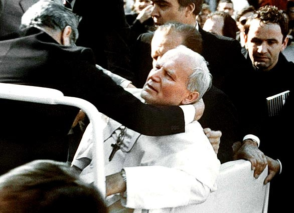 As he entered St. Peter's Square to address an audience on 13 May 1981, Pope John Paul II was shot and critically wounded by Mehmet Ali Ağca, a Turkish gunman who was a member of the militant fascist group Grey Wolves.