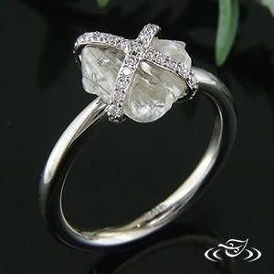 White Gold band featuring a Rough Diamond held by bead-set Diamond criss-cross. So Boho!