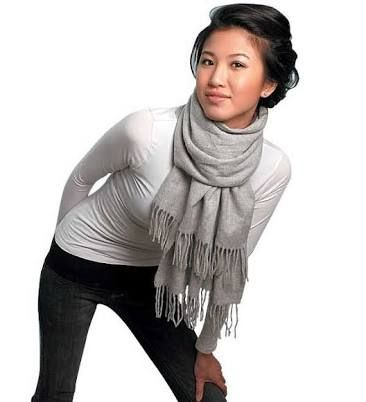 This scarf style adds detail at the front which is perfect for a smaller bust. A fitted top maintains the silhouette and hair is best styled up to elongate the neckline. Photo credit- Time Out Chicago