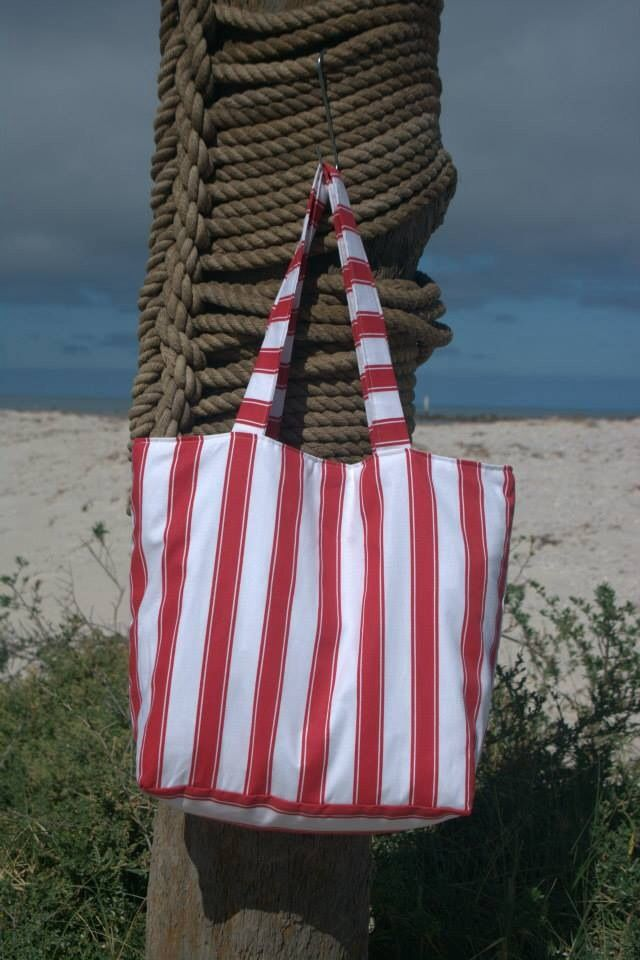 Red stripe beach bag lined with white cotton fabric. Outer made from exterior upholstery fabric.  Measures approx 51x41x15cm. $30.00 each