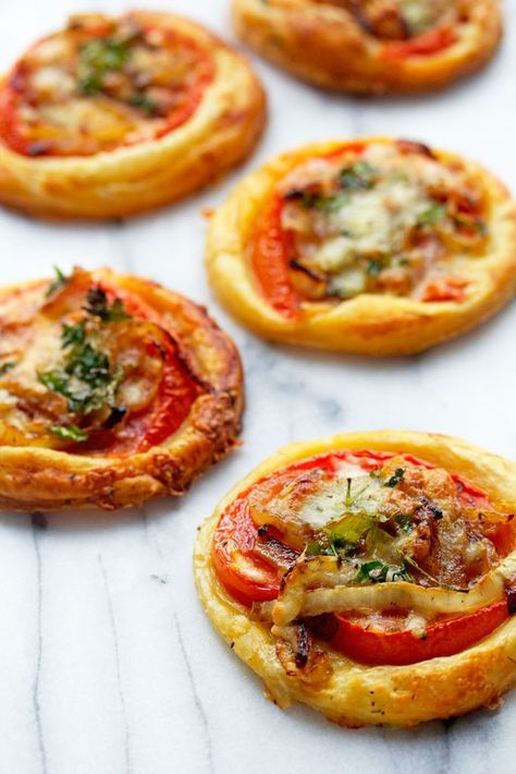 simple tomato tarts made with puff pastry, decadent caramelized onions and cheese