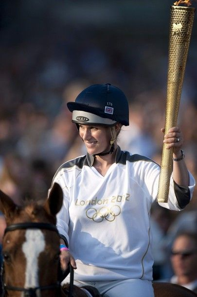 Olympic torchbearer Zara Phillips arrives on her horse Toy Town as she brings Olympic flame to Cheltenham Racecourse on May 23, 2012 in Cheltenham, England. The Olympic Flame arrived in the UK last Friday and is now on day five of a 70-day relay involving 8,000 torchbearers covering 8,000 miles. 23.5.2012