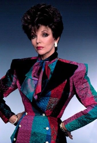 Joan Collins on Dynasty wearing a typical 80s look - the shoulder pads and the bow around the neck.