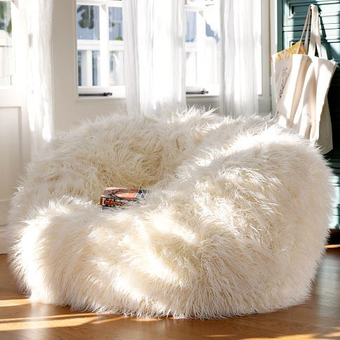 """A plush super shaggy slipcover in ivory makes this beanbag the softest seat in the house."" I want that"