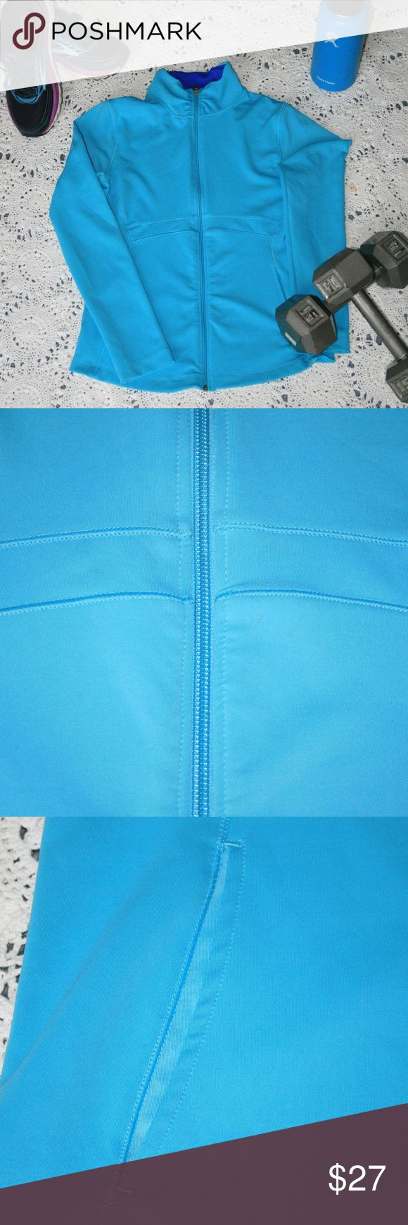 New Balance Sports Jacket Light blue spandex lightning dry jacket. Holds warmth really well when working out, but also great for exercising and keeping you cool because of air flow. Zips all the way up to the neck. Tiny smudge on jacket front (pictured) but nearly invisible. New Balance Jackets & Coats