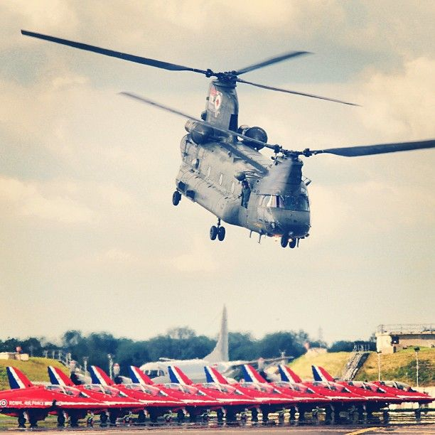 A Chinook flies over the Red Arrows at RIAT 2012, RAF Fairford, UK  www.airtattoo.com